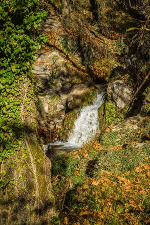 Scenic mountain autumn landscape with river and   watergfalls  near village Langadia, Peloponnese,  Greece Stock Photo