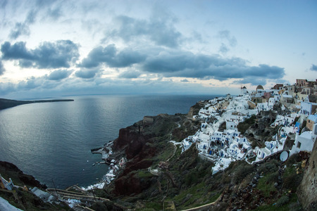 Image of white city on a slope of a hill in Oia, Santorini, Greece Stock Photo