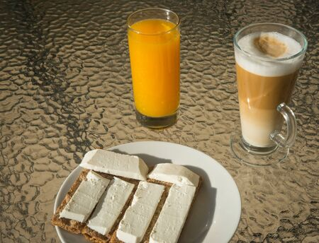 queso fresco blanco: Coffee, orange juice and crispbread with soft white cheese - morning breakfast.