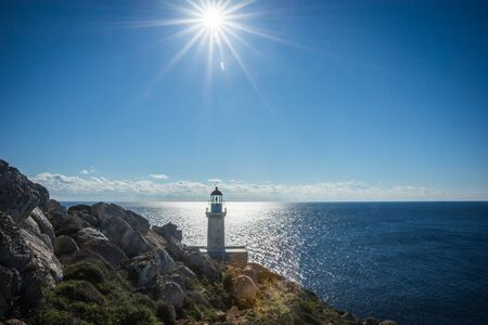 Full sun lighting over the modern lighthouse at the most southern edge of greek mainland & Most Serene Stock Photos. Royalty Free Most Serene Images