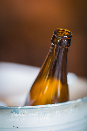 beer bucket: Image of beer bottle in  metal bucket on blurry background