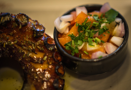 Image of grilled octopus and fresh vegetable salad Stock Photo