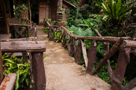 Houses on stilts with wooden ladders in the tropical rain forest of Khao Sok sanctuary, Thailand