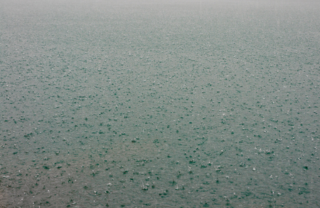 Surface of water in rain drops at Chieou Laan lake  in Thailand