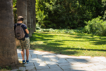 packsack: Image of a man in the real botanic garden, Athens, Greece Stock Photo