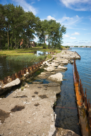 spit: Ruins of   wharf of times of World War 2 near base of Noitif on Baltic Spit in Kaliningrad Region, Russia Stock Photo
