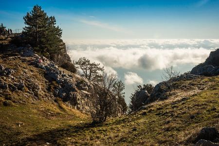 Landscape above and below  clouds on Mount Ai Petri in  Crimea in Russia Stock Photo