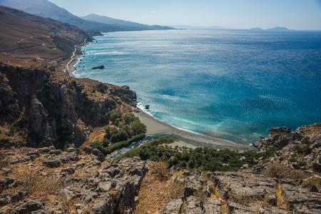 River flowing into sea at Preveli beach, Crete, Greece