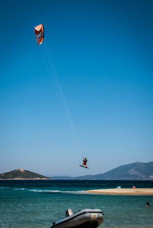Golden beach at Marmari, Greece - June 24, 2012, Sky-surfers playing on Golden beach in Marmari on Evia island in Greece in  Greece