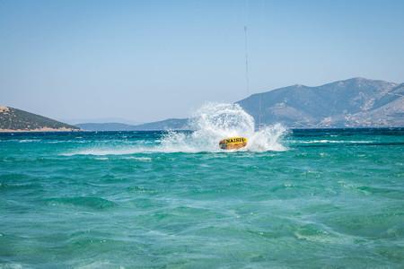 Golden beach at Marmari, Greece - June 24, 2012, Sky-surfers playing on Golden beach in Marmari on Evia island in Greece