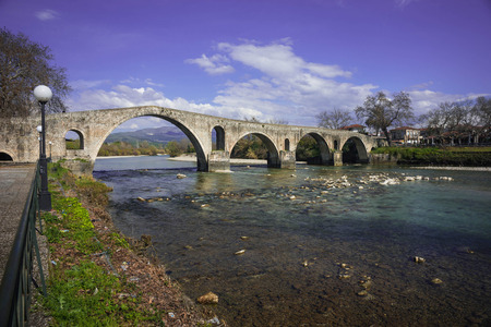 Image of Medieval bridge over river Arahthos in Arta, Greece