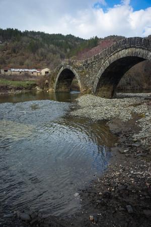 Image of ancient snone bridge over river in Zagorohoria, Greece