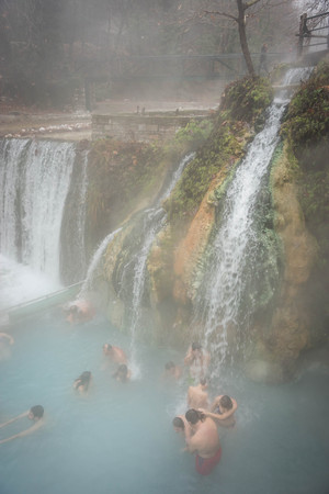 Lutra Posar, Greece - January 04, 2016: People bathing in thermal spring in fog at Loutra Posar in Greece Editorial