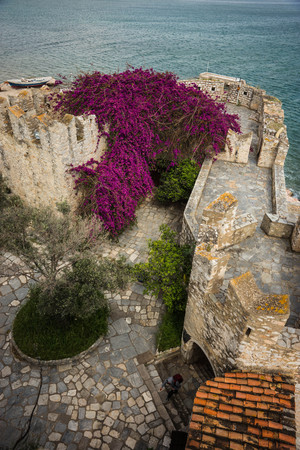 Image of ruins of  fortress and seascape on Bourtzi island in Greece