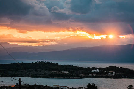 Image of scenic sunset over the sea in Portoheli on Peloponnese in Greece