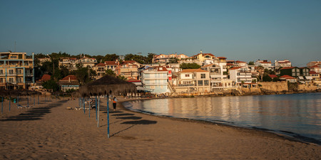 Urban and seascape at sunset in Arcudi on Peloponnese in Greece