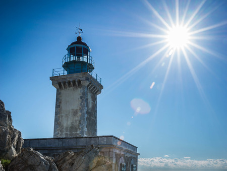 Full sun lighting over the modern lighthouse at the most southern edge of greek mainland