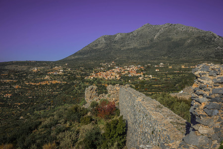Mountain landscape with ruins of Kalef fortress in inner Mani on Peloponnese in Greece