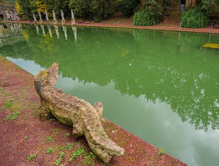 Ancient pool called Canopus, surrounded by greek sculptures in Villa Adriana (Hadrians Villa) and reflections in water in Tivoli, Italy