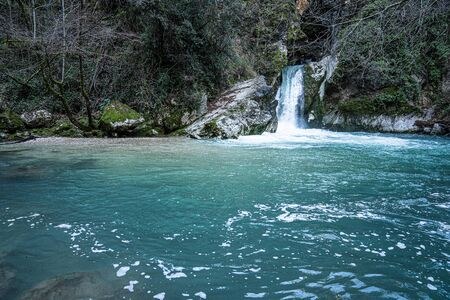 Waterfall on Lake Saint Benedict near city of Subiaco in Italy