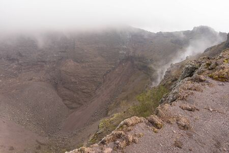 Image of Vesuvius Crater in the clouds in cloudy weather, Italy