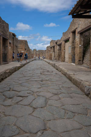 Pompei, Italy - June 14, 2020, Masked people walking on the ruins of Pompeii during isolation due to coronavirus Editorial