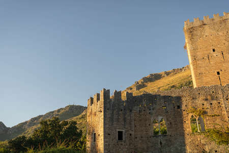 Image of ruins of old castle in Cisterna di Latina at sunset in Italy