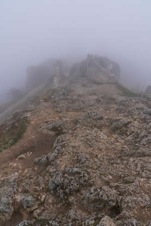 Image of ruins of medieval castle in clouds and fog in Rocca Calascio, Abruzzo, Italy Stock Photo