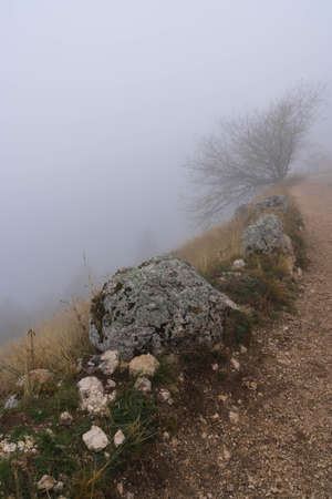 Autumn mountain landscape in clouds and fog in Abruzzo mountains in Italy Stock Photo