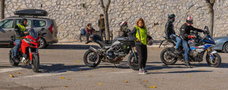 Orvinio, Italy - October 31, 2020, Masked and unmasked traveling bikers who stop to eat in Italian Borgo Orvinio during second wave of coronavirus (Covid19), non-observance of social distance in Italy