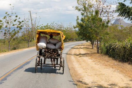 Horse drawn vehicle on the road in the district Guantanamo - Cuba