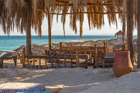 romantic view with tables and benches at beach of Mahmya island egypt