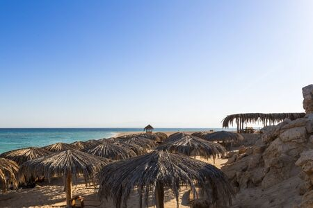 view from hill to the beach, sea and sunshades of Mahmya island egypt