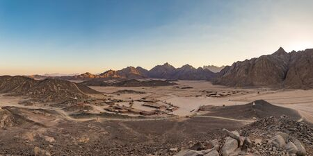 Panorama of the Beduine Village in the Arabic stone desert near hurghada egypt at sunset