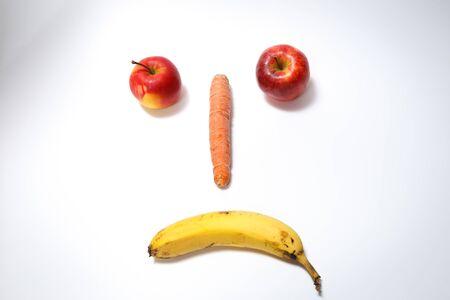 Sad smiling fruit face isolated on white background