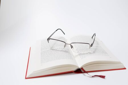 Glasses and book isolated on white Background Standard-Bild