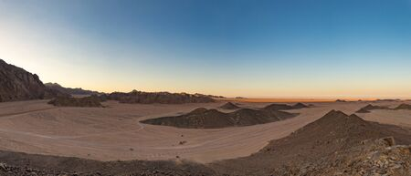 Panorama of the Arabic stone desert near hurghada egypt at sunset