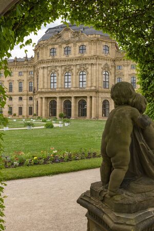 View of the Residenz in Wuerzburg Germany through the pergola with old Sculptures