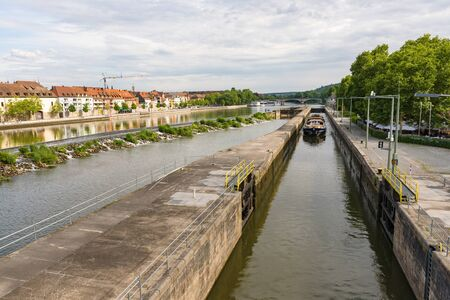 WURZBURG, GERMANY - MAY 20, 2018: View from the old Main bridge to the Main Canal with entering ship Editorial