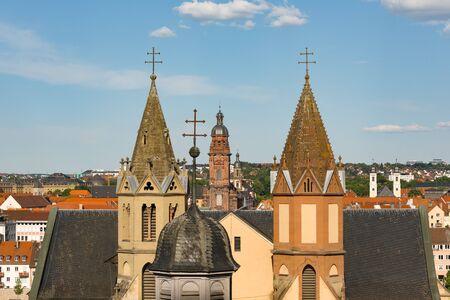 WUERZBURG, GERMANY - May, 20, 2018: Towers and Main Building of Parish Church St. Burkard Wuerzburg Germany