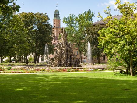 Erlangen, Germany, August 18, 2019: View of the fountain in baroque palace garden in Erlangen Bavaria, Germany Standard-Bild - 139325042