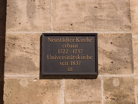 Erlangen, Germany, August 18, 2019: Metal Sign with inscription dates of construction and university church Neustaedter Church of Erlangen in Germany