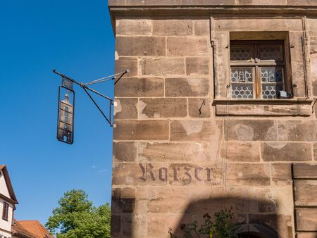 Erlangen, Germany, August 18, 2019: Front view and Shield with symbol of the water tower from the Former water tower of the city of Erlangen Germany