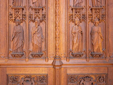 Dreux, France, April 30, 2019: Entry door with artistic carving of the Chapel Royal Saint Louis Editorial