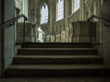 Dreux, France, April 30, 2019: staircase from the basement to the roundtrip inside of Chapel Royal Saint Louis