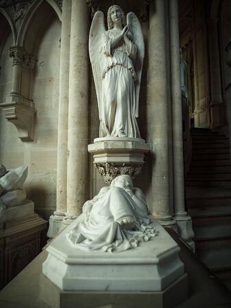 Dreux, France, April 30, 2019: Sculpture above a tomb inside of the Chapel Royal Saint Louis