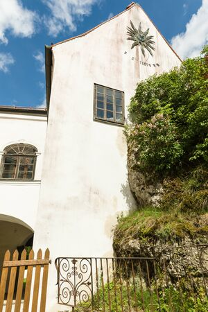Etzelwang, Germany, May 25, 2017: Neidstein Castle is a 16th century castle in the Bavarian Upper Palatinate. Wall with sundial. From 2006 to 2009 owned by Nicolas Cage