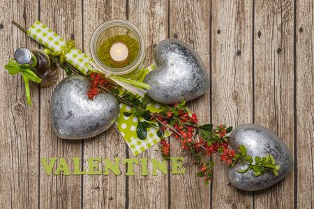 Abstract Romantic wooden Background with hearts, flowers, candle oil and words valentine Standard-Bild - 137756391