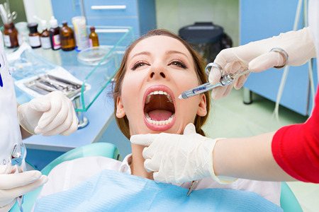 root canal: Closeup portrait young female, his assistant isolated background clinic office Stock Photo