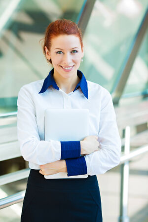enrolled: Closeup portrait happy, smiling business woman. Corporate, education life concept. Female student with folders, isolated background company office. Positive human emotions, facial expression, attitude Stock Photo